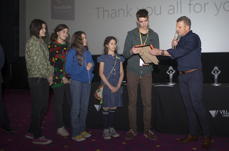 Secondary Second place winners. The Zakanj family accepting on behalf of Jessica and Mary Zakanj for First Light – In Search of the Sun